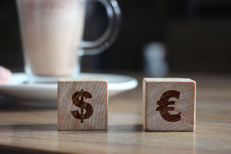 euro and dollar on wooden blocks sign concept. EU word currency business concept.