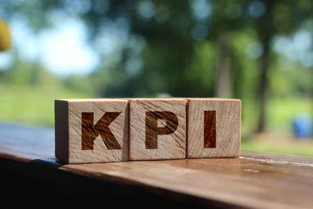 KPI Word Written In Wooden Blocks, Key Performance Indicator. Business concept.