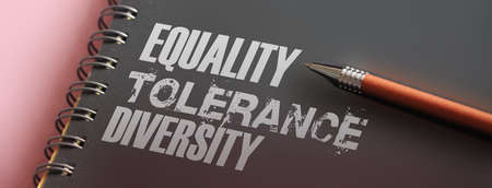 Equality Tolerance Diversity words on uppervpages of copybook. Social tolerance concept. in career and education Selective focus. Stock Photo