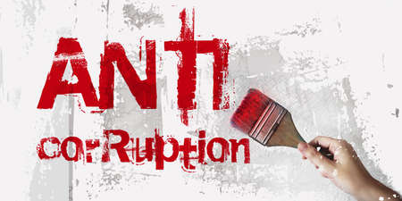 ANTI CORRUPTION Hand drawing words with paintbrush. Anti money laundering business and government concept