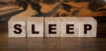 sleep word written on wood blocks. Healthcare concept.