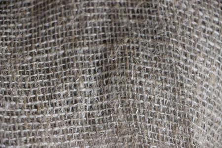 Burlap canvas textile closeup material texture background.