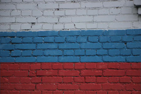 Flag of Russia painted onto a grunge brick wall.