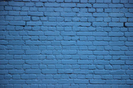Old brick wall painted into solid blue.