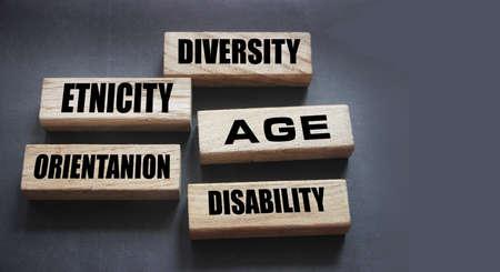 Diversity Etnicity age orientation disability words on wooden blocks. Social concept.