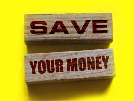 Wooden blocks twith ext Save Your Money. Business and finance concept.
