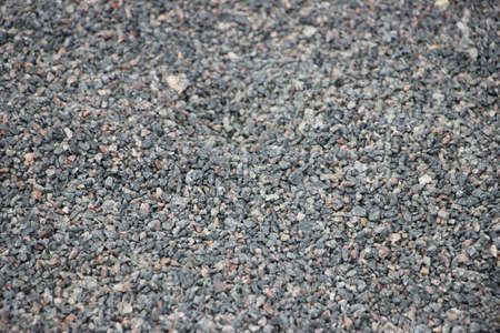 Crushed gray small gravel texture background Stock Photo