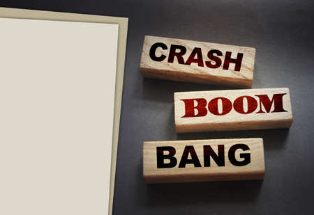 Crash boom bang words on wooden blocks on black background. Unexpected crisis, failure or bankruptcy business concept. End of relationship concept.