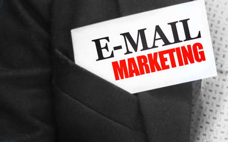 Email marketing words on card in businessman suit upper pocket. Business marketing client oriented concept.