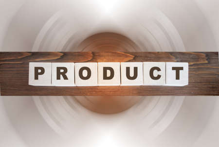 Product word written on wood block. Cube wooden block with alphabet combine the word Product on wooden background. Business and trading concept Imagens