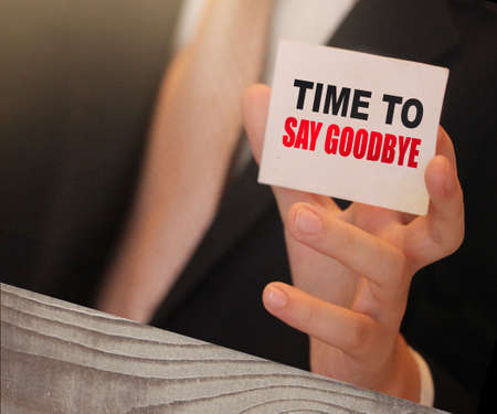 Time to Say Goodbye words on a card in hand of businessman. Business agreement termination concept.