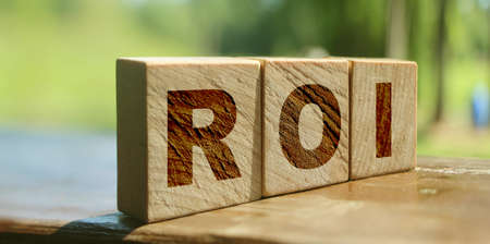 ROI. Wooden cubes with letters ROI. Return on investment business concept.