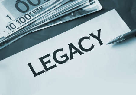 Legacy word on page, pen and hundred Euro bills. Last will legal concept. Banque d'images