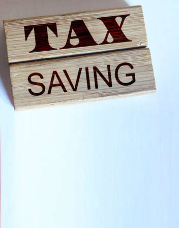 TAX saving words on wood blocks, wallet, coins. Business concept Archivio Fotografico