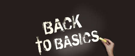 Back to basics written with chalk on blackboard. Elementary school education or small business first steps concept