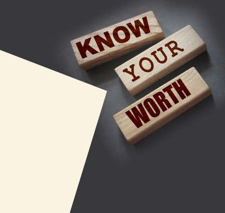 Know Your Worth on wooden blocks. Self motivation coaching HR concept