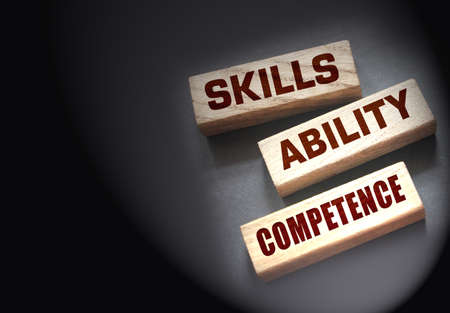 Skills ability competence words in wooden blocks concept. Career and business success concept