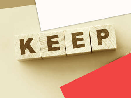 Keep word on wooden blocks and leather wallet. Saving things as they are. Save money concept