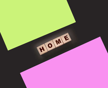 Wooden cubes with the word home, home on a black background. Real estate business or Emigration consept.