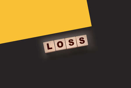 Wooden cubes with LOSS word on blacktable. Financial loss busines concept