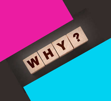 Why Closeup of word with question mark on wooden cubes on dark grey desk background. Reason why business or relationship concept