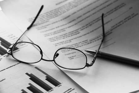 Business legal document concept : Pen and glasses on a agreement form Archivio Fotografico