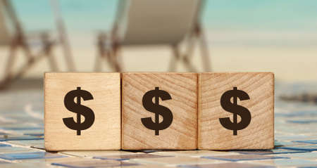 Money saving and saving concept - wooden cubes with dollar sign. Close up. Archivio Fotografico