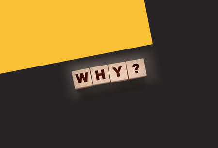 Why Closeup of word with question mark on wooden cubes on dark gray desk background. Reason why business or relationship concept.