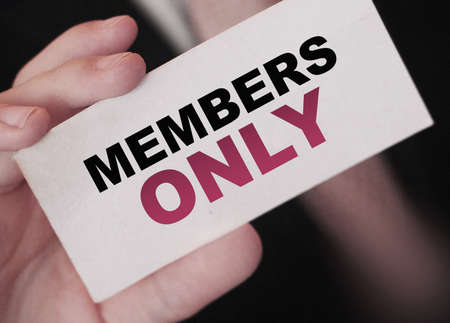 MEMBERS ONLY on a card Businessman holds. VIP clients in business concept. Archivio Fotografico