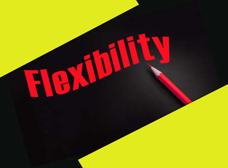 Flexibility text printed on black, yellow pencil besides. Work and life balance concept