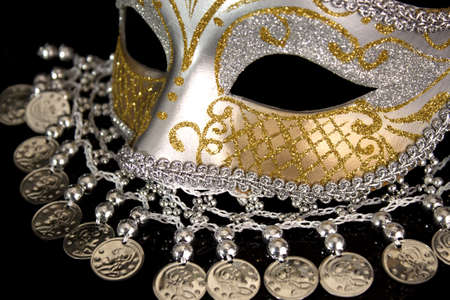 Silver coin carnival mask on a black background photo