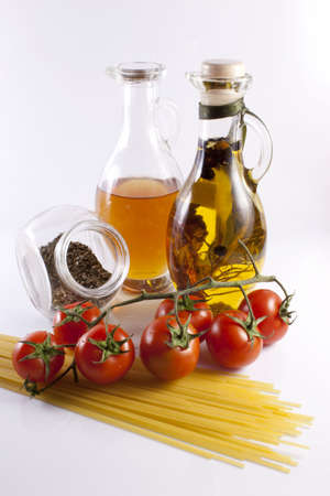 Olive oil and pasta on a white background Stock Photo - 12251355