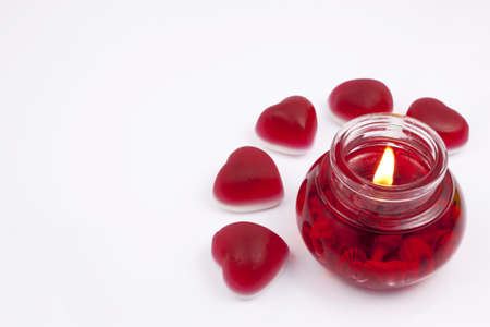 Red candle with hearts on a white background Stock Photo