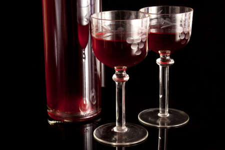 Oryginal glasses with red alcohol on a black background Stock Photo - 12597393