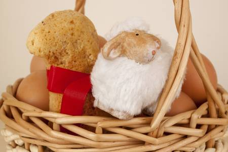 Easter basket with eggs and sheep photo