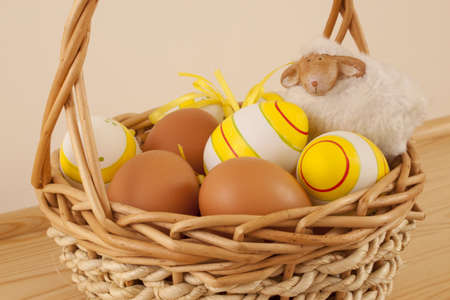 Easter basket with colored eggs and sheep Stock Photo