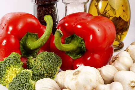 Colored vegetables - red pepper, green broccoli and white garlic Stock Photo