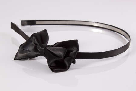 Black hair headband with bow on a white background Stock Photo - 13025720