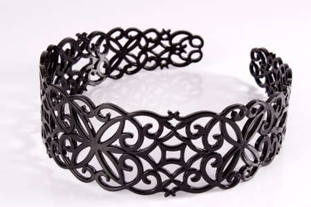 pili: Black lace hair band on a white background