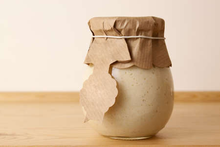 homely: Spicy homely horseradish in a jar Stock Photo
