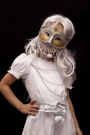 Girl in a Venetian mask and a white wig on a black background photo