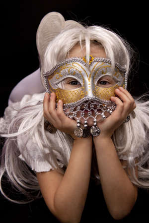 A pretty girl in carnival mask photo