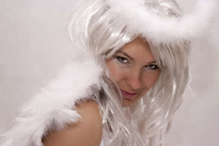 Beautiful woman dressed as angel on a white background