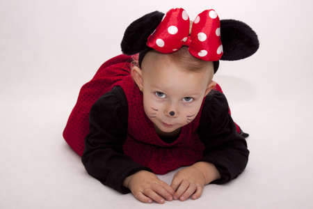 Small girl dressed as Minnie Mouse