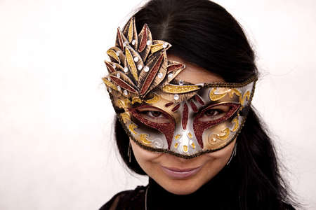 Smiled woman with venetian mask photo