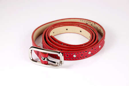 Red narrow belt for women on the white background