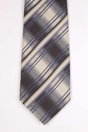 granatowy: Granatowy i beżowy w kratkę krawat na białym tle