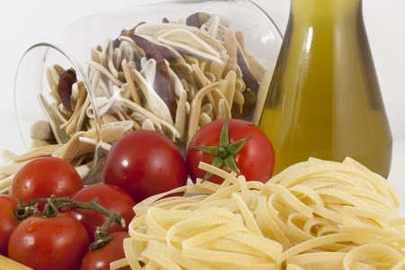 Composition of few kinds of pasta and tomatoes