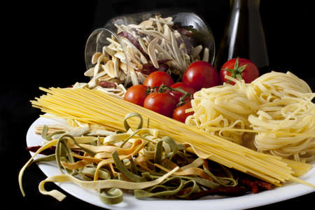 Few kinds of pasta on the plate photo