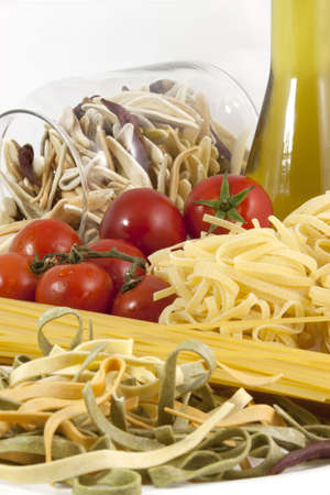 Pasta, tomatoes and olive oil on the white background photo